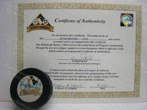 Bryan Trottier Autographed Puck with a Pittsburgh Penguins Hologram Certificate